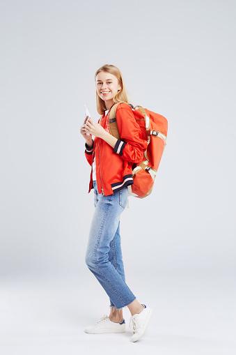 Studio Portrait of blond woman wearing backpack - gettyimageskorea