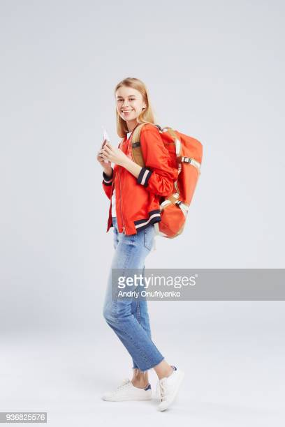 Studio Portrait of blond woman wearing backpack
