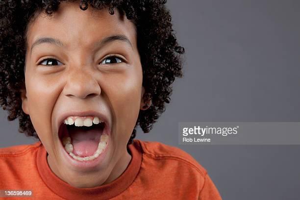 Studio portrait of boy (8-9) screaming