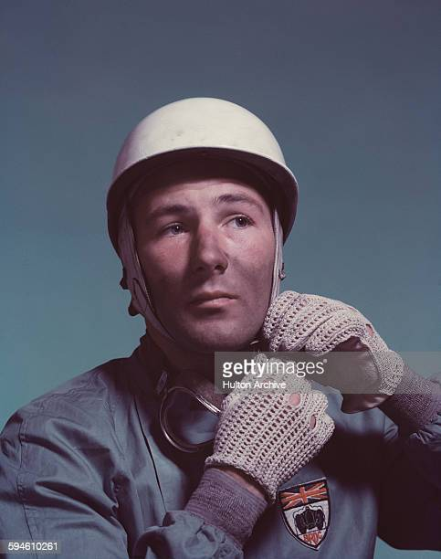 Studio portrait of British racing driver Stirling Moss circa 1955 seen wearing the badge of the British Racing Drivers' Club