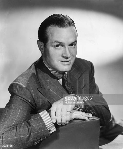 Studio portrait of Britishborn entertainer Bob Hope wearing a pinkie ring smiling at the camera