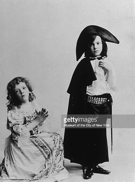 Studio portrait of brother and sister singing and dancing partners Fred Astaire and Adele Astaire as children in costume Fred is dressed as a girl...