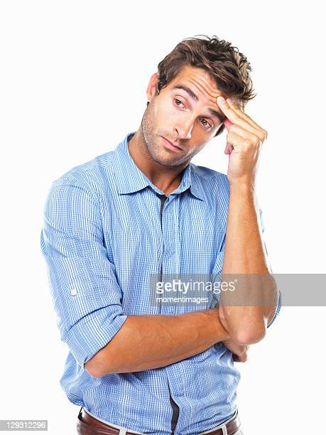 studio portrait of business man rubbing forehead and looking away - worried stock pictures, royalty-free photos & images