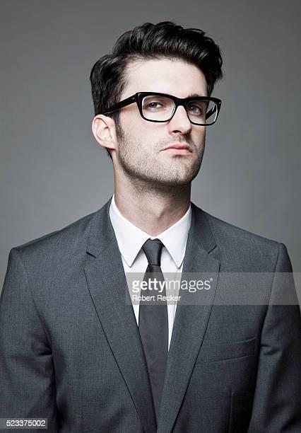 Studio portrait of business man wearing glasses