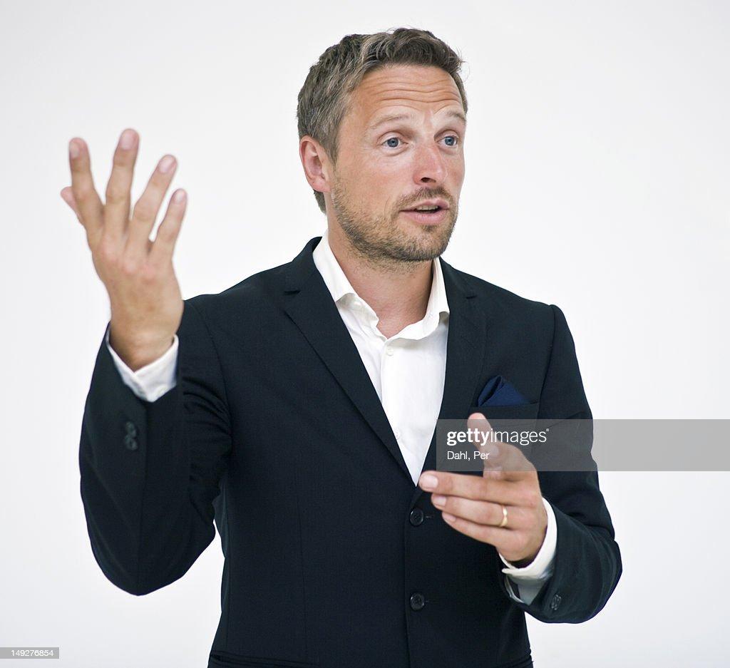 Studio portrait of businessman gesturing : Foto de stock