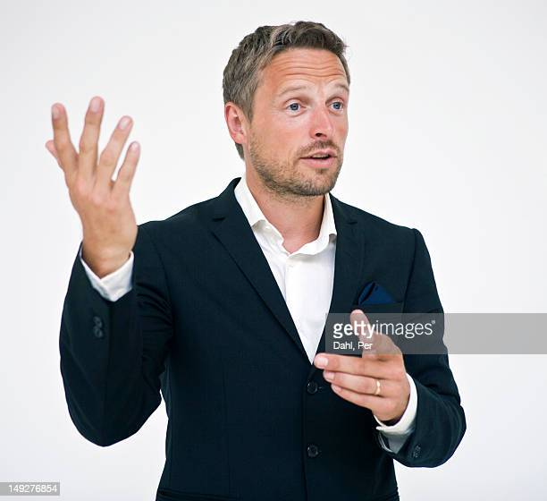 studio portrait of businessman gesturing - 身ぶり ストックフォトと画像