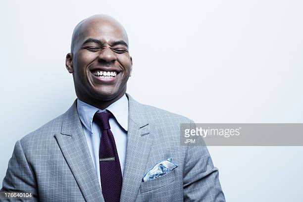 studio portrait of businessman laughing - gray suit stock pictures, royalty-free photos & images