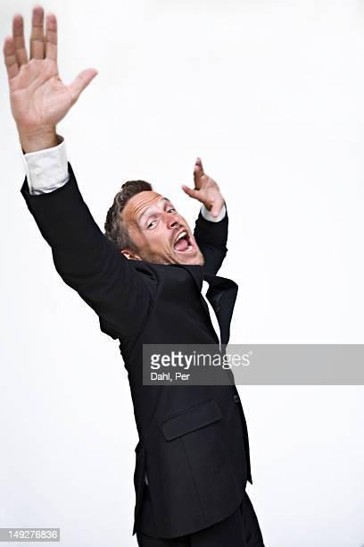 Studio portrait of businessman yelling