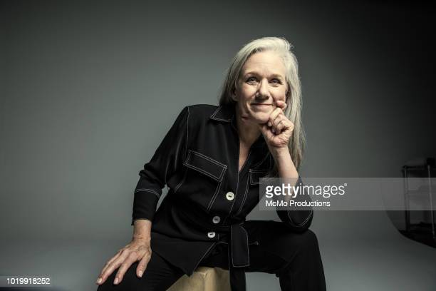 studio portrait of businesswoman - 60 64 years stock pictures, royalty-free photos & images