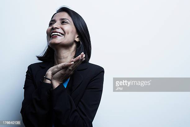 studio portrait of businesswoman smiling - indian subcontinent ethnicity stock pictures, royalty-free photos & images