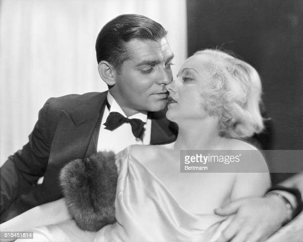 Studio portrait of Clark Gable and Carole Lombard kissing The couple made one film together No Man of her Own 1932 and were married in 1939 until her...
