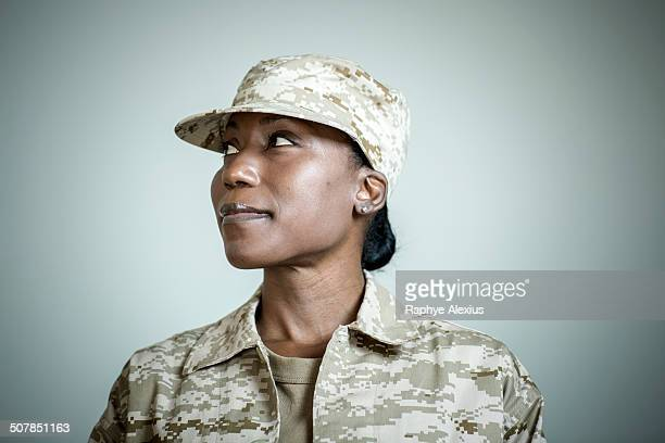Studio portrait of confident female soldier looking sideways