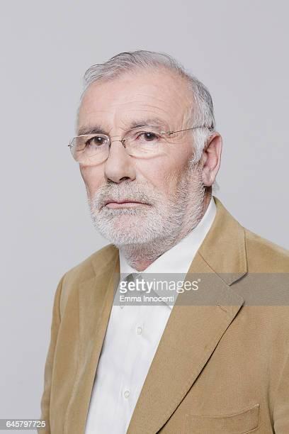 Studio portrait of confident man with spectacles