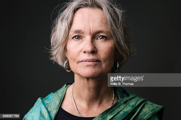 studio portrait of confident mature woman - 50 54 years stock pictures, royalty-free photos & images