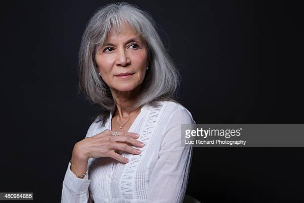 Studio portrait of confident senior woman
