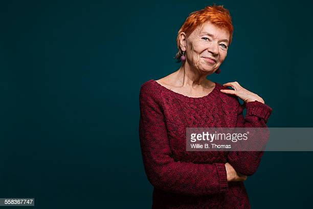 studio portrait of confident senior woman - dyed red hair stock pictures, royalty-free photos & images