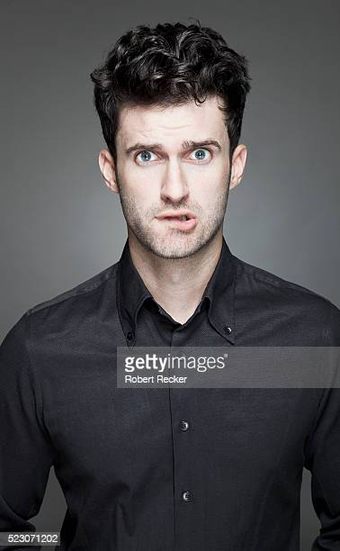 Studio portrait of confused young man
