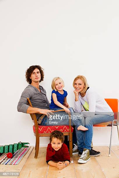 Studio portrait of couple sitting with son and daughter