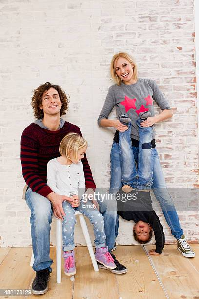 Studio portrait of couple waving fun with son and daughter
