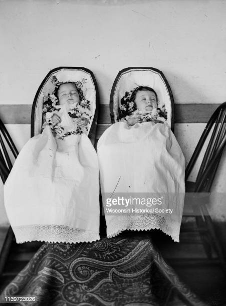 Studio portrait of deceased twin infants in coffins Black River Falls Wisconsin 1886 They are Robert and Janet Fitzpatrick born July 5 died April 20...