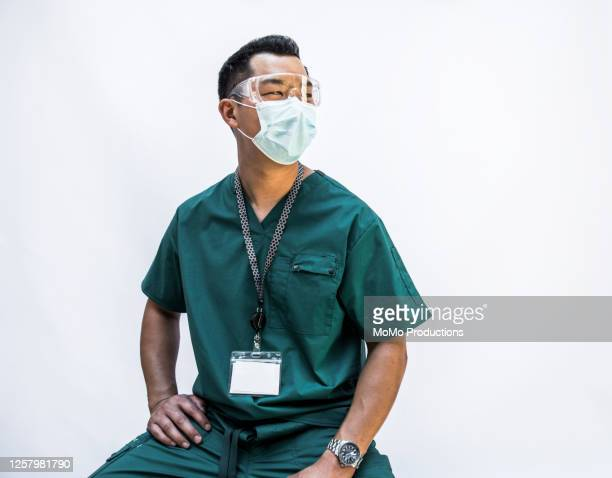 studio portrait of doctor/healthcare worker - protective workwear stock pictures, royalty-free photos & images