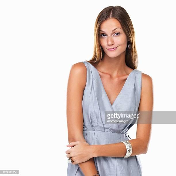 Studio portrait of elegant woman smirking