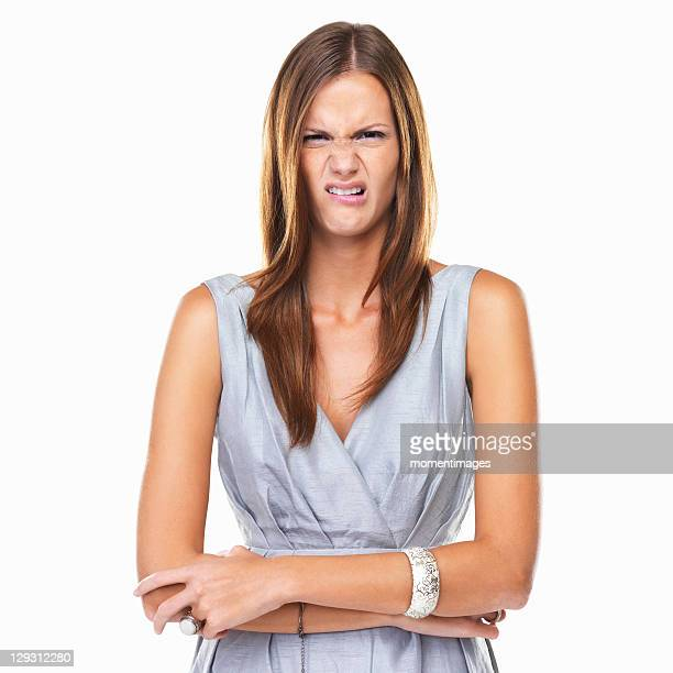 Studio portrait of elegant woman with disgusted expression