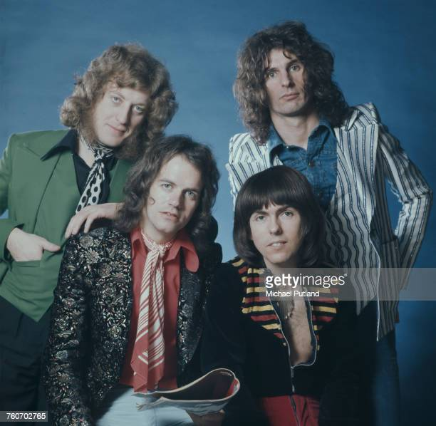 Studio portrait of English glam rock group Slade posed in London circa 1974 The band are from left singer Noddy Holder bassist Jim Lea guitarist Dave...