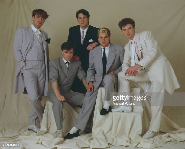 Studio portrait of English pop group Spandau Ballet, posed in London in May 1983. Left to right: bassist Martin Kemp, drummer John Keeble, singer...