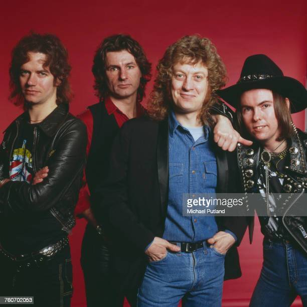 Studio portrait of English rock group Slade posed in London circa 1975 The band are from left bassist Jim Lea drummer Don Powell singer Noddy Holder...
