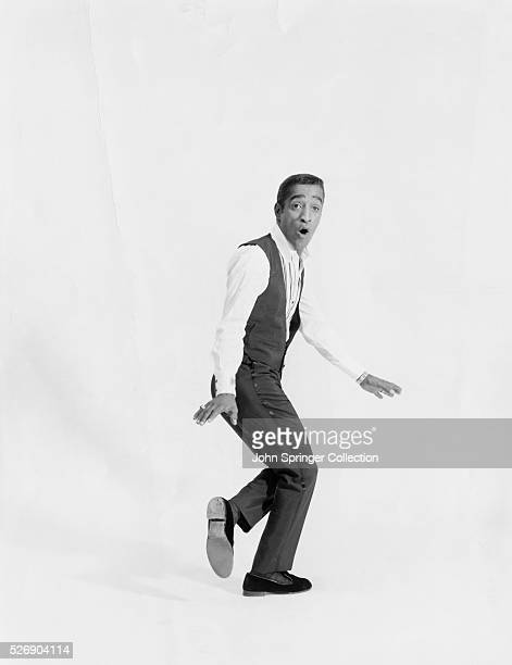 Studio portrait of entertainer Sammy Davis Jr in midtap Undated