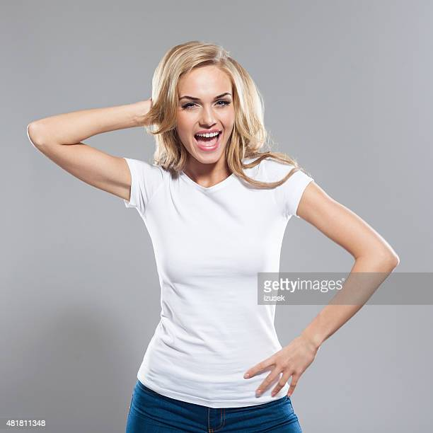 Studio Portrait of excited blond hair young woman