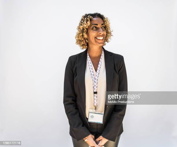 studio portrait of female doctor/healthcare worker - blazer jacket stock pictures, royalty-free photos & images