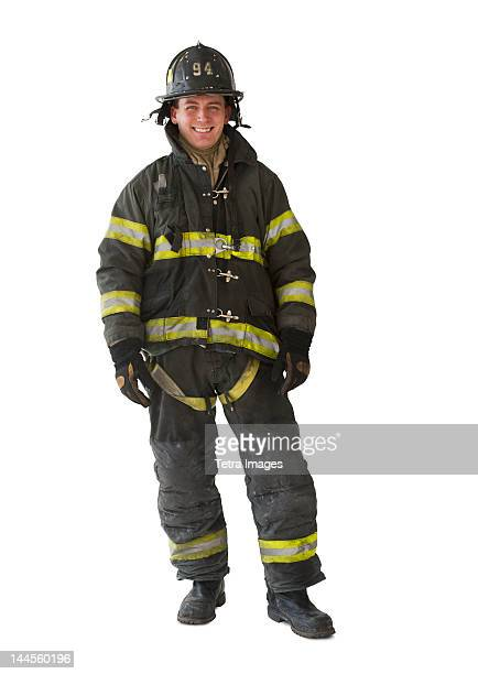 studio portrait of firefighter - firefighter stock pictures, royalty-free photos & images