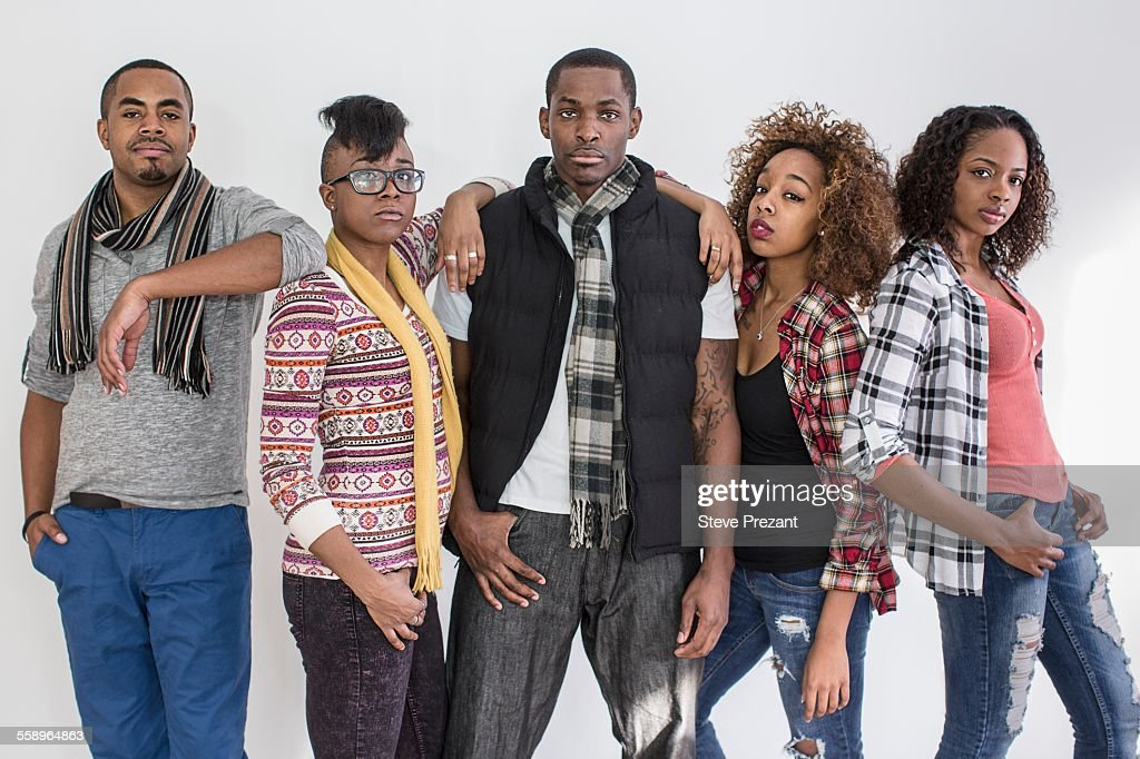Studio portrait of five serious staring adult friends : Stock Photo