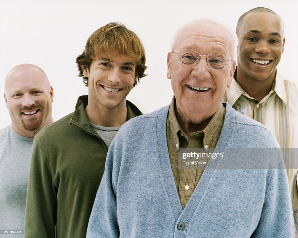 Studio Portrait of Four Laughing Men of Mixed Ages : Stock Photo