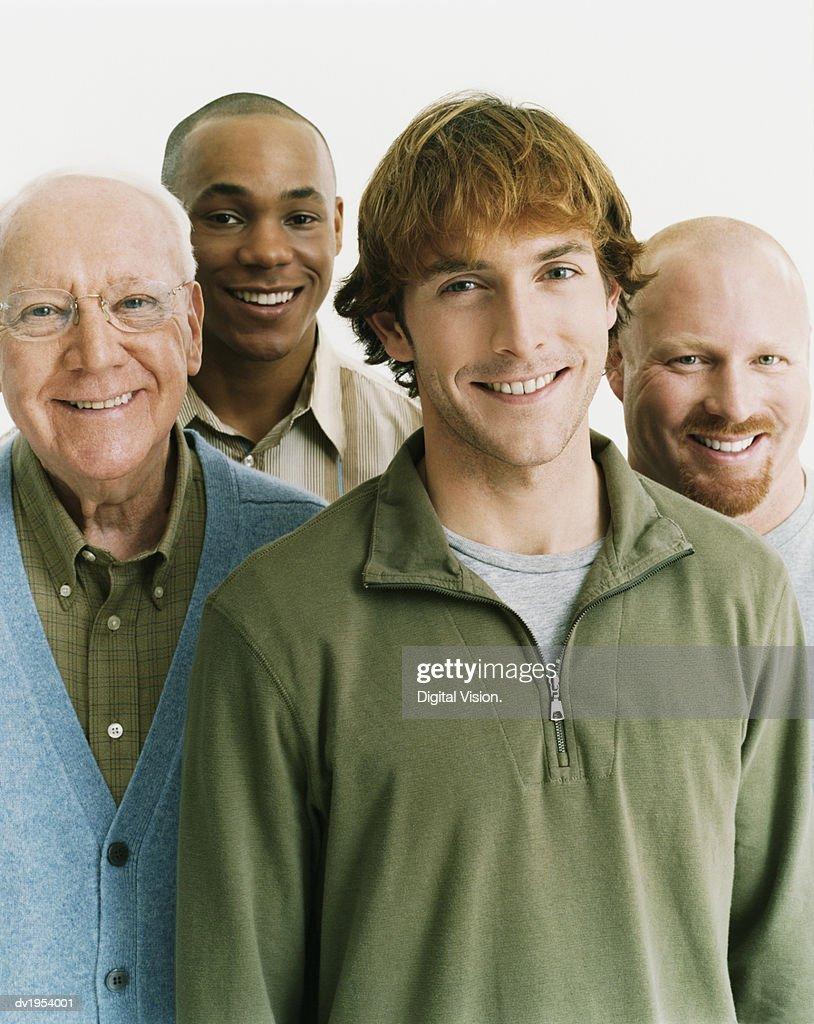Studio Portrait of Four Men of Mixed Ages : Stock Photo