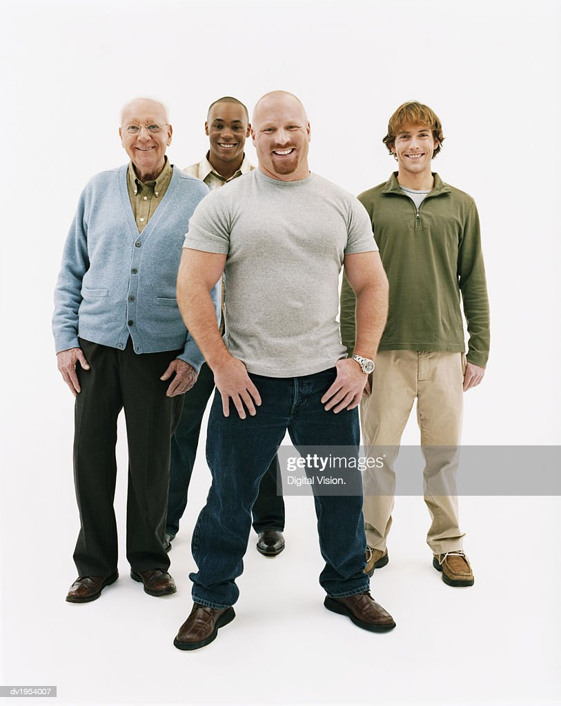 Studio Portrait of Four Smiling Men of Mixed Ages : Stock Photo