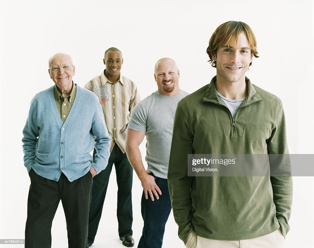 Studio Portrait of Four Smiling Men of Mixed Ages, Thirtysomething Man at the Front : Stock Photo