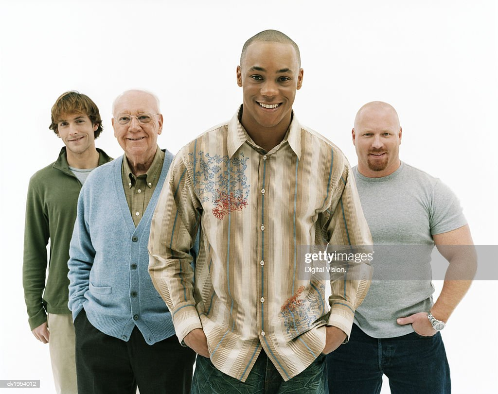 Studio Portrait of Four Smiling Men of Mixed Ages, Young Man at the Front : Stock Photo