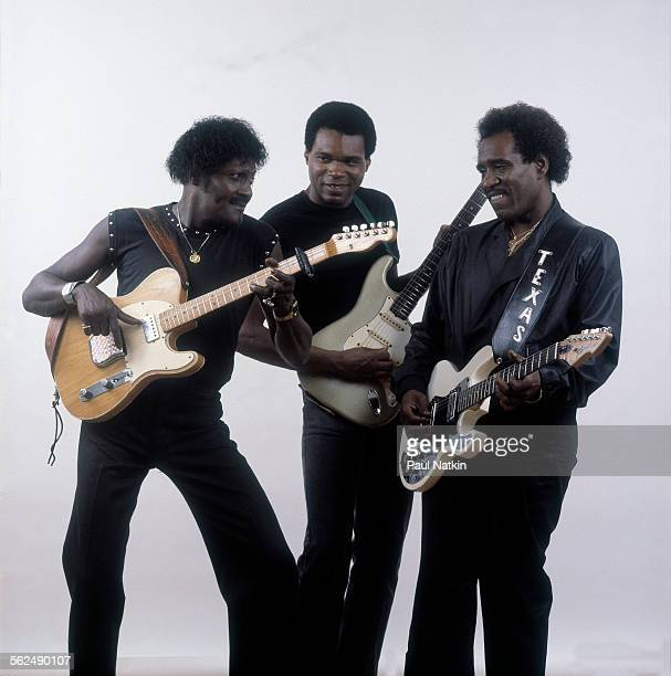 Studio portrait of from left American Blues musicians Albert Collins Robert Cray and Johnny Copeland as they play their guitars Chicago Illinois June...