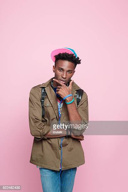 Studio portrait of funky afro american young man
