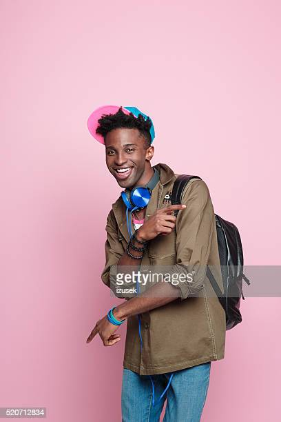 Studio portrait of funky, excited afro american student
