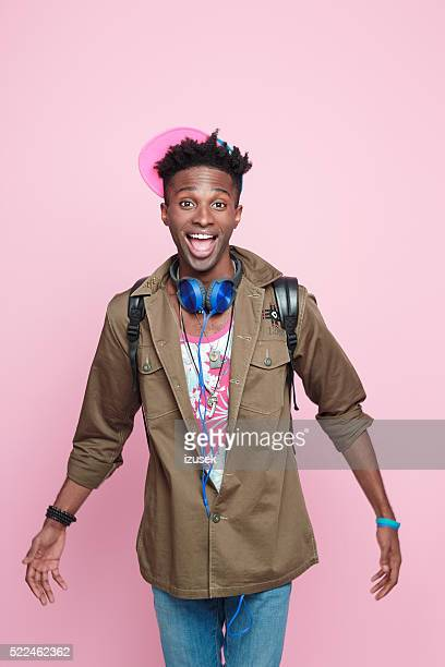 Studio portrait of funky, excited afro american young man