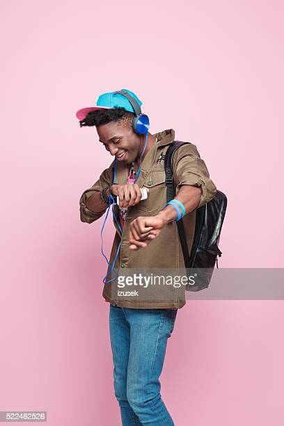 studio portrait of funky, excited afro american young man - hi tech moda stock pictures, royalty-free photos & images