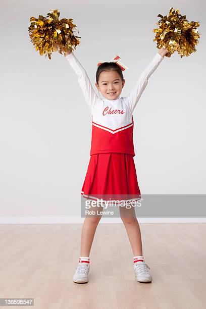 studio portrait of girl (8-9) cheerleading - チアリーダー ストックフォトと画像