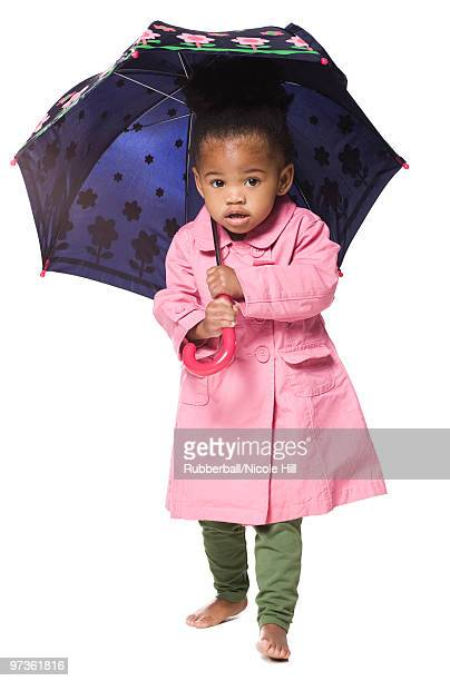 studio portrait of girl (18-23 months) holding umbrella - 18 23 months stock pictures, royalty-free photos & images