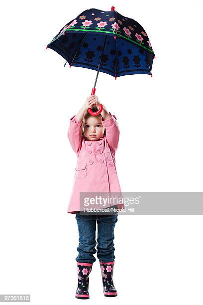 Studio portrait of girl (2-3) holding umbrella