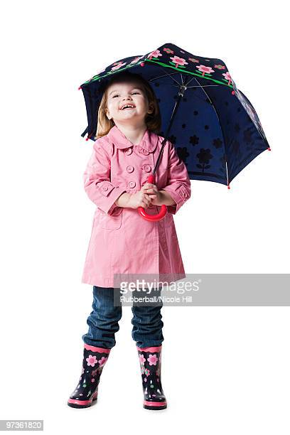 studio portrait of girl (2-3) holding umbrella - overcoat stock pictures, royalty-free photos & images
