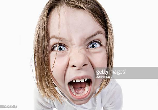 Studio portrait of girl (6-7) screaming